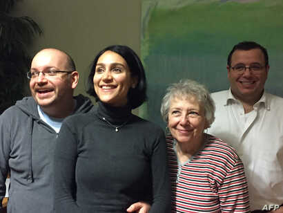 Former Iranian prisoner Jason Rezaian, left, is shown with his family shortly after his release. From second left, his wife, Yeganeh Salehi, his mother, Mary Rezaian, and his brother Ali Rezaian.