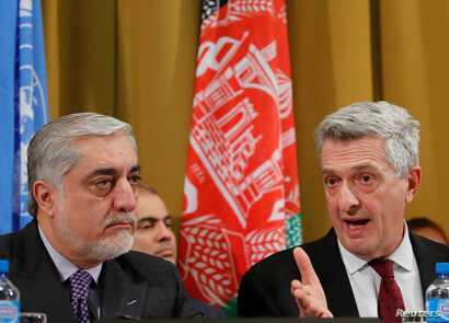 Afghanistan's Chief Executive (L) Abdullah Abdullah and United Nations High Commissioner for Refugees Filippo Grandi attend a two-day conference on Afghanistan at the United Nations in Geneva, Nov. 27, 2018.