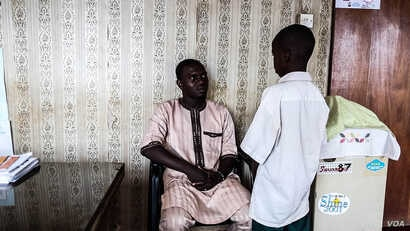 Anas Umar  is fond of his nephew. He says he cries at night, thinking about what the boy has gone through. (C. Oduah/VOA)