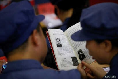 Participants read a textbook during a history lesson at the Red Culture Training Center during a Communist team-building course  in Jinggangshan, Jiangxi province, China, Sept. 14, 2017.