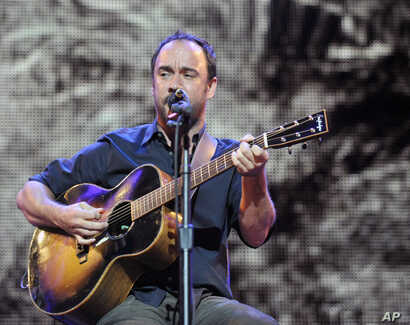 FILE - Dave Matthews performs during the Farm Aid 2013 concert at Saratoga Performing Arts Center in Saratoga Springs, N.Y.