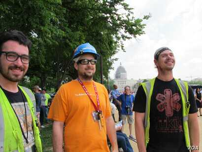 The flyover drew spectators including, from left, John Jumalon, Daniel McConnell and Ross Merchant. They were taking a break from construction work on the National Gallery of Art. Behind them is the Capitol dome under scaffolding for repairs.