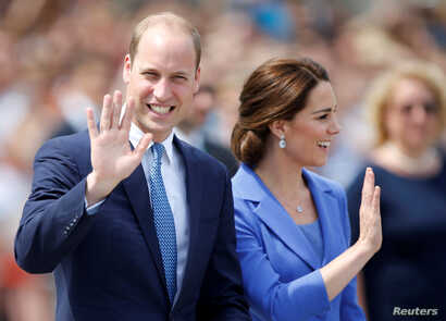 FILE - Prince William, the Duke of Cambridge, and his wife Catherine, the Duchess of Cambridge, visit Brandenburg Gate in Berlin, Germany, July 19, 2017.