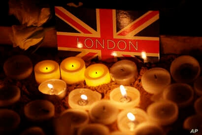 People light candles at a vigil for the victims of Wednesday's attack, at Trafalgar Square in London, March 23, 2017.