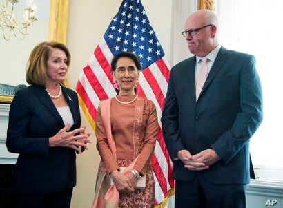 Myanmar leader Aung San Suu Kyi, center, meets House Minority Leader Nancy Pelosi of Calif.. and Rep. Joseph Crowley, D-N.Y., on Capitol Hill in Washington, Sept. 15, 2016.