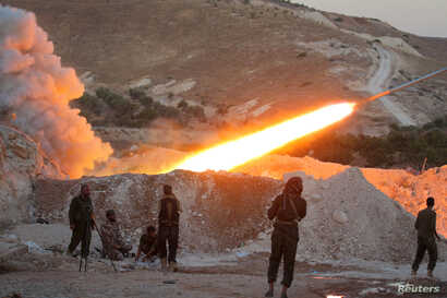 Free Syrian Army fighters launch a Grad rocket from Halfaya town in Hama province, towards forces loyal to Syria's President Bashar al-Assad stationed in Zein al-Abidin mountain, Syria Sept. 4, 2016.
