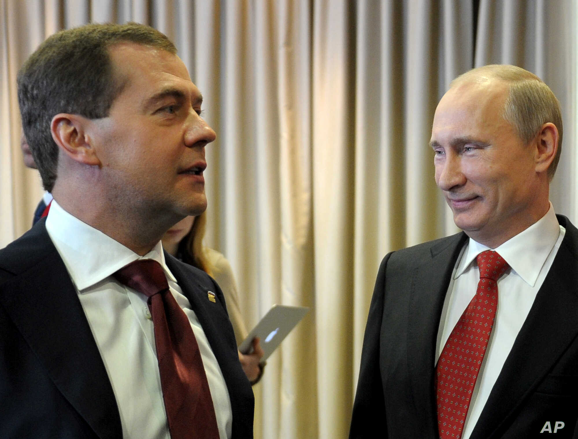 Russian President Vladimir Putin, right, and Prime Minister Dmitry Medvedev attend the United Russia party annual congress in Moscow, May 26, 2012.