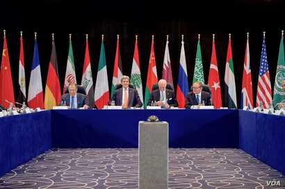 U.S. Secretary of State John Kerry sits with Russian Foreign Minister Sergey Lavrov, United Nations Special Envoy for Syria Staffan de Mistura, and United Nations Deputy Secretary-General Jan Eliasson on Feb. 11, 2016, at the Hilton Hotel join Munich...