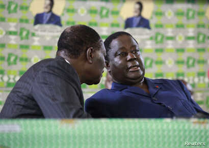 Then Presidential candidate Alassane Ouattara (L) speaks to Henri Konan Bedie of PDCI during Ouattara's investiture the alliance candidate for the 2nd round of the presidential elections, in Cocody, Abidjan, Nov. 10, 2010.