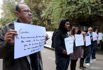 "Activists hold placards that read, among others, ""Giulio, one of us and killed like us,"" during a memorial for Giulio Regeni outside of the Italian embassy in Cairo, Egypt, Feb. 6, 2016."