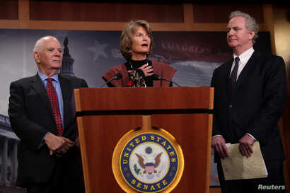 Sens. Ben Cardin (D-MD) (L), Lisa Murkowski (R-AK) (C) and Chris Van Hollen (D-MD) hold a press conference about a bipartisan solution after the failure of both competing Republican and Democratic proposals to end the partial government shutdown in b...