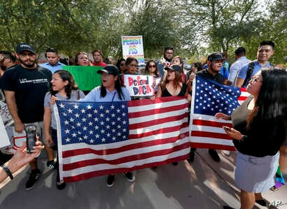 DACA supporters march to the Immigration and Customs Enforcement office to protest shortly after U.S. Attorney General Jeff Sessions' announcement that the Deferred Action for Childhood Arrivals (DACA), will be suspended with a six-month delay, Sept....