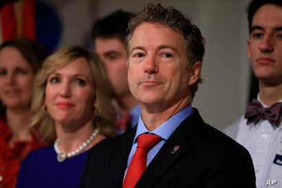 Republican presidential candidate, Sen. Rand Paul, R-Ky, stands with his wife Kelley and family members as he waits to speaks to supporters during a caucus night victory party at the Scottish Rite Consistory in Des Moines, Iowa, Feb. 1, 2016.