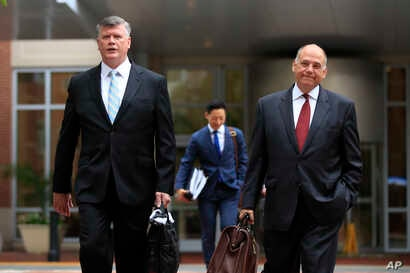 Kevin Downing, left, and Thomas Zehnle, attorneys for Paul Manafort, walk to the Alexandria Federal Courthouse in Alexandria, Va., Aug. 3, 2018, on day four of the former Donald Trump campaign chairman's tax evasion and bank fraud trial.