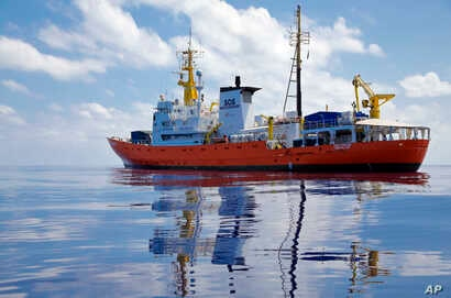 FILE - In this Wednesday, Aug. 23, 2017 file photo, Aquarius the vessel of NGOs, SOS Mediterranee and MSF drifts in the international waters north of Libya. Migrants trying to reach Europe face routine rape and sexual torture throughout their journey...