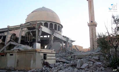 This undated frame grab from video posted online June 10, 2017 by the Aamaq News Agency, a media arm of the Islamic State group, shows a mosque that was damaged by bombardment by the U.S.-led coalition and U.S.-backed fighters in Raqqa.