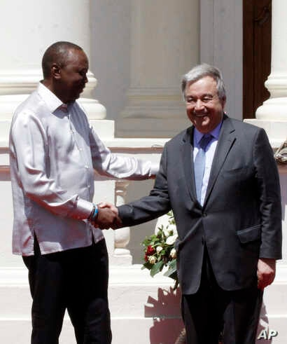 U.N. Secretary-General Antonio Guterres, right, shakes hands with Kenyan President Uhuru Kenyatta after holding a joint news conference at the State House in Nairobi, Kenya, March 8, 2017. Guterres has called for more stable funding and supp...