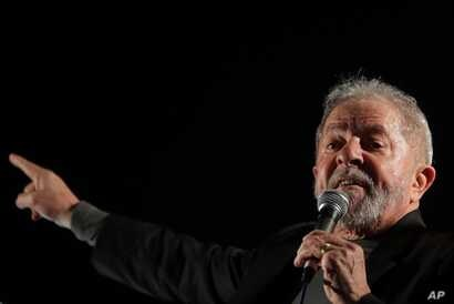 Brazil's former President Luiz Inacio Lula da Silva addresses supporters gathering to protest his conviction in Sao Paulo, Brazil, July 20, 2017. A judge in Brazil ordered the seizure of more than $2.8 million in pension funds from Silva in connectio...