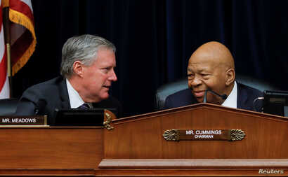 House Oversight and Reform Committee chairman Elijah Cummings (D-MD) confers with Ranking Member Rep Mark Meadows (R-NC) during a debate on the possibility of issuing a subpoena to a former White House security clearance chief.