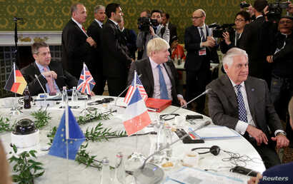 German Foreign Minister Sigmar Gabriel (L), Britain's Foreign Secretary Boris Johnson (C), and U.S. Secretary of State Rex Tillerson attend roundtable talks during a G7 for foreign ministers in Lucca, Italy, April 11, 2017.