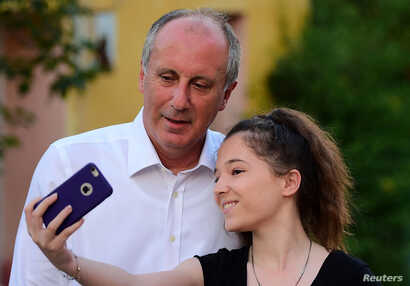 Muharrem Ince, presidential candidate of Turkey's main opposition Republican People's Party (CHP), poses for a selfie with a supporter of him in Elmalik village in Yalova province, Turkey, June 14, 2018.