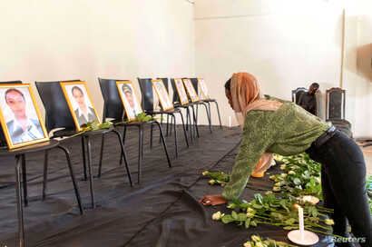A member of the Ethiopian Airline Pilots' Association mourns as she attends a memorial service for the Ethiopian Airlines Flight ET 302 plane that crashed, in Addis Ababa, Ethiopia, March 11, 2019.