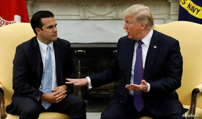 U.S. President Donald Trump meets with Puerto Rico Governor Ricardo Rossello in the Oval Office of the White House in Washington, Oct. 19, 2017.