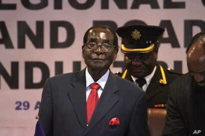 FILE - Zimbabwean President Robert Mugabe attends lasy years's Southern African Development Community (SADC) Heads of State and Government Extraordinary Summit in Harare, Apr. 29, 2015.