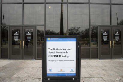 The Smithsonian Institution National Air and Space Museum is seen shuttered during the partial government shutdown, Jan. 4, 2019, in Washington.