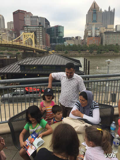 Kazam Hashimi's arrival at PNC Park, Aug. 1, 2017, is a welcome but unexpected part of a longer journey fleeing war in Afghanistan, where he worked as a translator for the U.S. Army. The park sits on the Allegheny River in Pittsburgh, Penn.