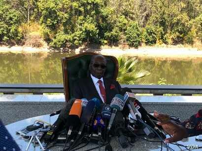 Former Zimbabwean President Robert Mugabe addressing journalists at his residence in Harare, July 29, 2018, on the eve of the country's elections where he endorsed Nelson Chamisa leader of the country's main opposition Movement for Democratic Chang...