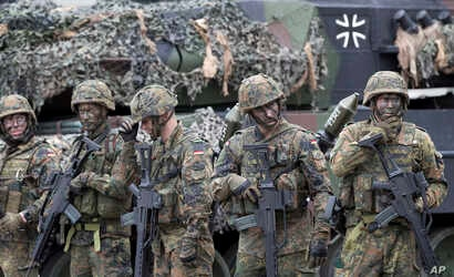 FILE - German Bundeswehr soldiers are seen during exercises with Lithuanian forces at the Rukla military base some 130 kms (80 miles) west of Vilnius, Lithuania, Aug. 25, 2017.