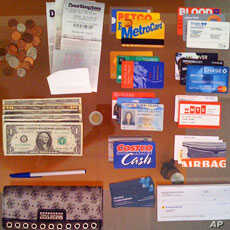 It's not uncommon to have three or four (or more) forms of identification in your wallet.  And to have your name appear differently on each of them