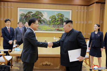 FILE - North Korean leader Kim Jong Un shakes hands with Chung Eui-yong, who led a special delegation of South Korea's president, in this photo released by North Korea's Korean Central News Agency, March 6, 2018.