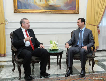 Syria's President Bashar al-Assad, right, meets Turkey's Prime Minister Tayyip Erdogan in Aleppo, Feb. 6, 2011.