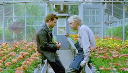 """Bradley Cooper (left) and Jeremy Irons in a scene from """"The Words"""" (Photo courtesy CBS Films)"""