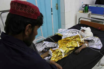 An injured boy receives treatment at a hospital after an airstrike in Helmand province, southern Afghanistan, Nov. 28, 2018. Civilians and Taliban fighters were killed in the strike as Afghan government forces battled insurgents.