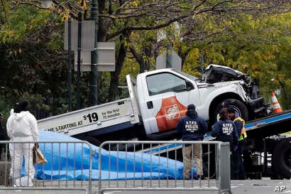The Home Depot truck used in the bike path attack is removed from the crime scene, Nov. 1, 2017, in New York.