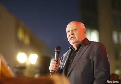 Former Soviet President Mikhail Gorbachev visits the former Berlin Wall border crossing point Checkpoint Charlie, in Berlin, November 7, 2014.