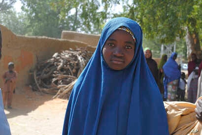 Aishat Alhaji , one of the kidnapped girls from the Government Girls Science and Technical College Dapchi who was freed, is photographed after her release,  in Dapchi, Nigeria, March. 21, 2018.