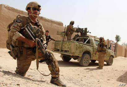 Afghan National Army commandos take position during a military operation in Helmand province, Oct. 2, 2016.