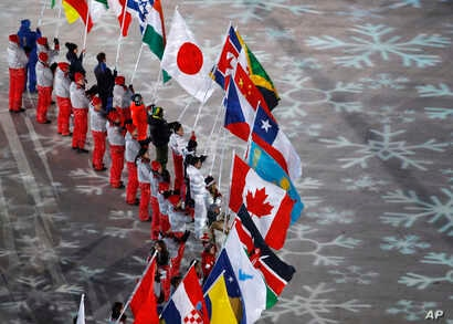 Flag bearers from various nations attend the closing ceremony of the 2018 Winter Olympics in Pyeongchang, South Korea, Feb. 25, 2018.