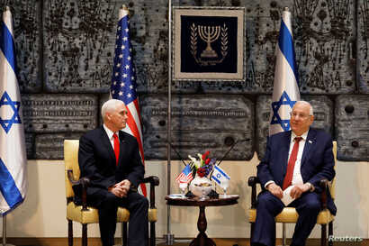 U.S. Vice President Mike Pence sits next to Israeli President Reuven Rivlin during a meeting at the President's residence in Jerusalem, Jan.  23, 2018.