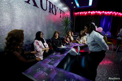 Women sit at Luxury Time, the city's first women-only restaurant, in Irbil, Iraq, July 17, 2018.