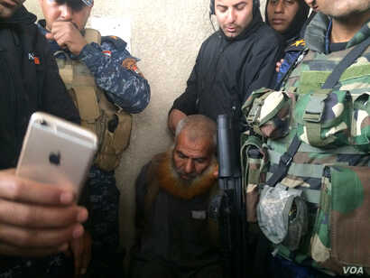 The day after capturing this Mosul neighborhood, Iraqi forces arrested this suspected militant after being informed of his whereabouts by civilian neighbors in Mosul, Iraq, Mar. 2, 2017.