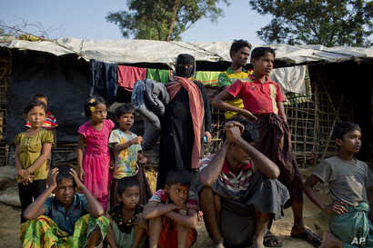 Rohingya Muslims, who crossed over from Myanmar into Bangladesh, wait to collect aid at Kutupalong refugee camp in Ukhiya, Bangladesh, Dec. 21, 2017.