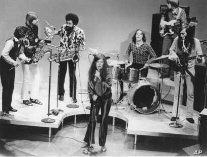 FILE - In this December 1969 file photo, singer Janis Joplin performs with her group Big Brother and the Holding Company. On drums is Dave Getz.