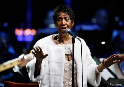 FILE - Aretha Franklin performs during the commemoration of the Elton John AIDS Foundation 25th year fall gala at the Cathedral of St. John the Divine in New York City, in New York, Nov. 7, 2017.