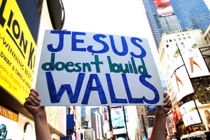 Interfaith religious leaders protest against Republican U.S. presidential candidate Donald Trump outside a hotel where he was to meet with evangelical leaders in New York City, June 21, 2016.
