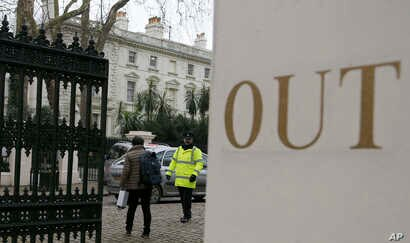 A van pulls into the grounds of the Russian Embassy in London,  March 20, 2018.